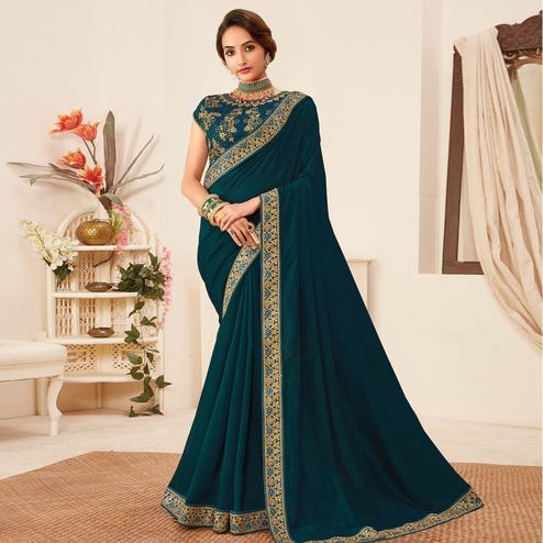 Captivating Peacock Blue Colored Partywear Emboidered Vichitra Silk Saree