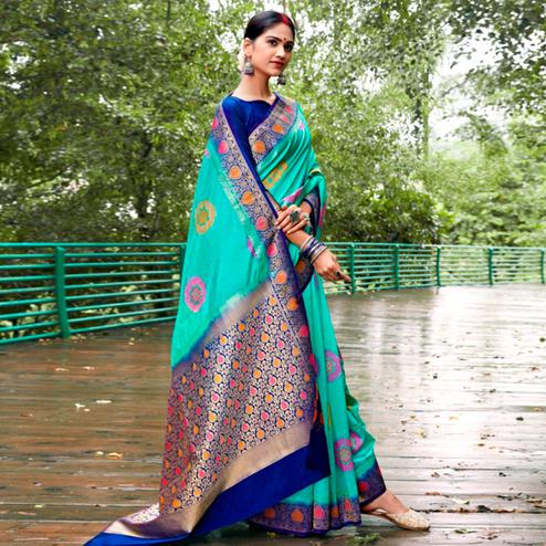 Intricate Turquoise Green Colored Festive Wear Woven Silk Saree
