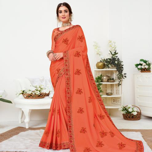 Adorning Dark Peach Colored Partywear Embroidered Crepe Georgette Saree