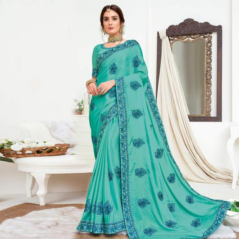 Adorable Aqua Blue Colored Partywear Embroidered Crepe Georgette Saree