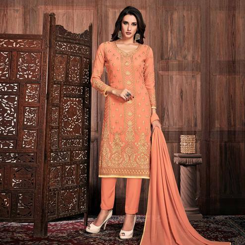 Flattering Peach Colored Partywear Embroidered Georgette Suit