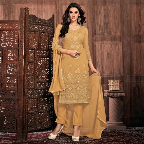 Flamboyant Beige Colored Partywear Embroidered Georgette Suit
