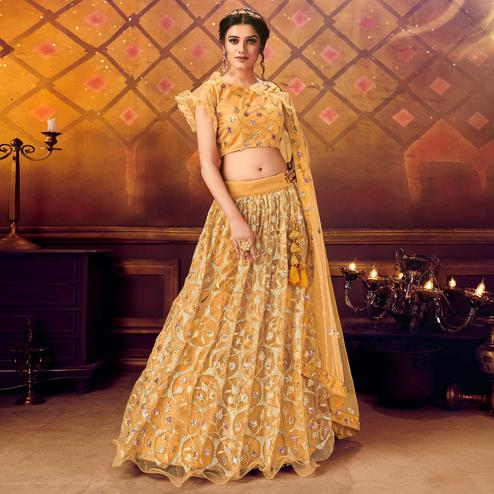 Intricate Yellow Colored Partywear Embroidered Soft Net Lehenga Choli