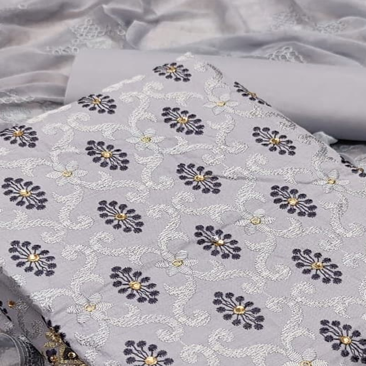 Ideal Grey Colored Partywear Embroidered Cotton Dress Material