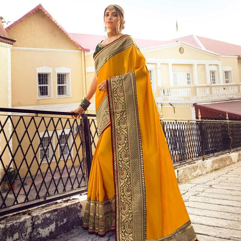 Prominent Yellow Colored Partywear Embroidered Pure Tassar Saree
