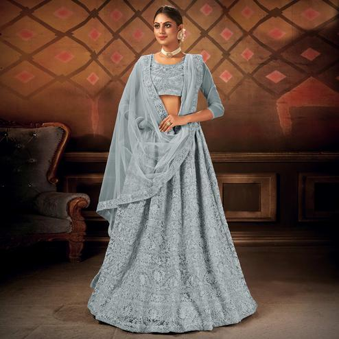 Opulent Grey Colored Partywear Embroidered Net Lehenga Choli