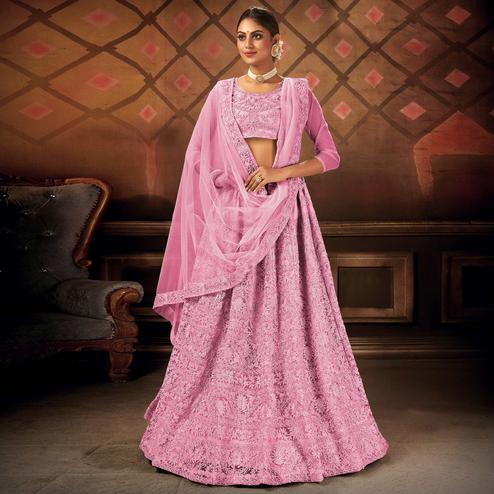 Energetic Pink Colored Partywear Embroidered Net Lehenga Choli