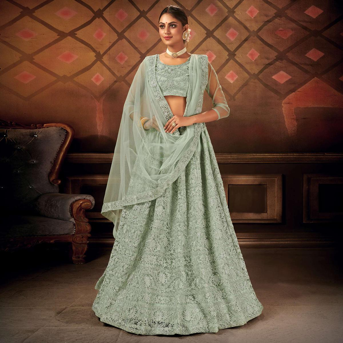 Exceptional Pastel Green Colored Partywear Embroidered Net Lehenga Choli