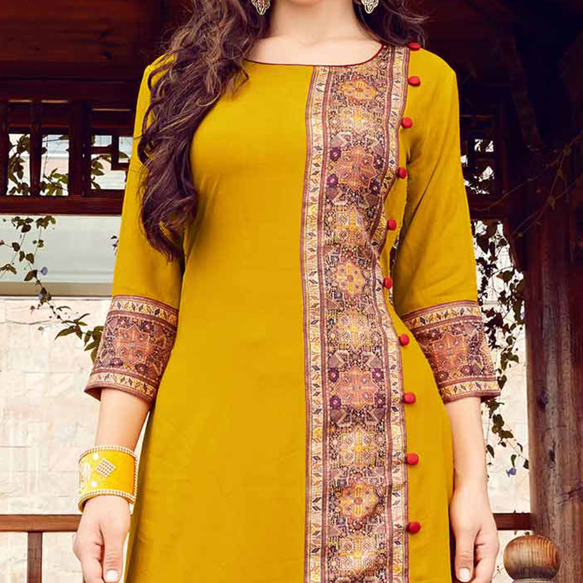 Gorgeous Yellow Colored Fancy Designer Rayon Kurti