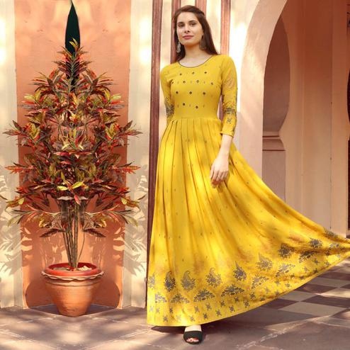 Graceful Yellow Colored Partywear Heavy Rayon Anarkali Style Long Kurti