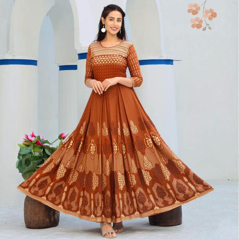 Captivating Rust Orange Colored Partywear Heavy Rayon Anarkali Style Long Kurti