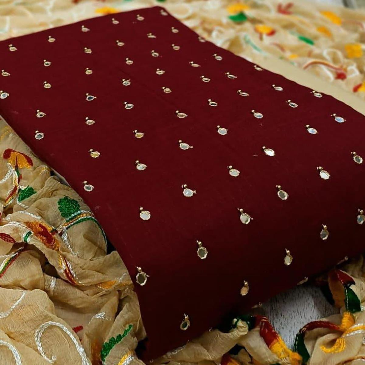Mesmerising Maroon Colored Partywear Mirror Work Cotton Dress Material