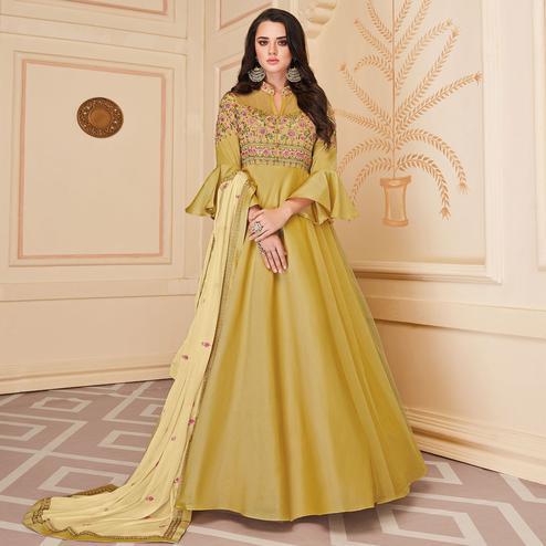 Blooming Mustard Colored Embroidered Work Party Wear Heavy Soft Silk Gown