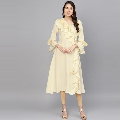AHALYAA - Cream Colored Partywear Angarkha Style Crepe Ruffled Kurta For Women
