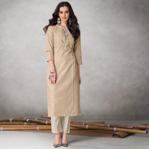 Exotic Beige Colored Party Wear Embroidered Self Weaved Cotton Kurti Pant Set