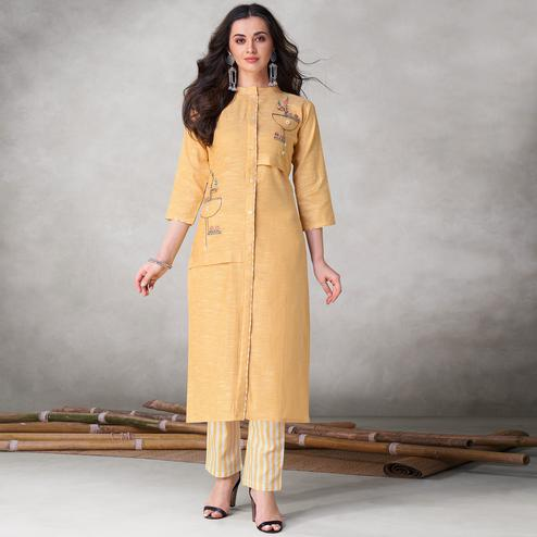 Eye-catching Yellow Colored Party Wear Embroidered Self Weaved Cotton Kurti Pant Set