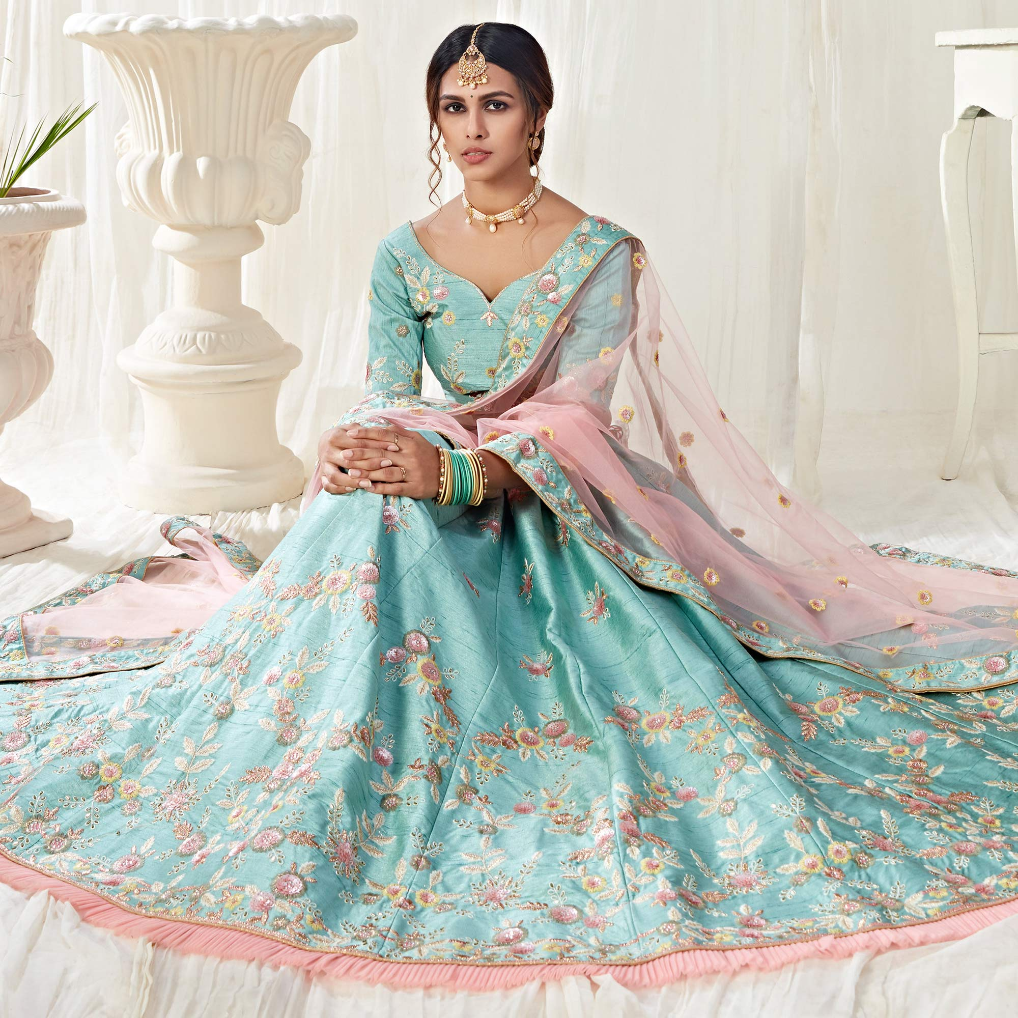 Blooming Ice Blue Colored Cording Thread & Sequence Embroidery Designer Wedding Wear Net With Mulberry Silk Lehenga Choli