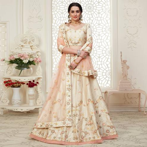 Ravishing Cream Colored Cording Thread & Sequence Embroidery Designer Wedding Wear Net With Mulberry Silk Lehenga Choli