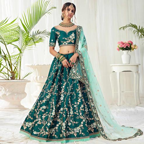 Engrossing Dark Green Colored Cording Thread & Sequence Embroidery Designer Wedding Wear Net With Mulberry  Lehenga Choli