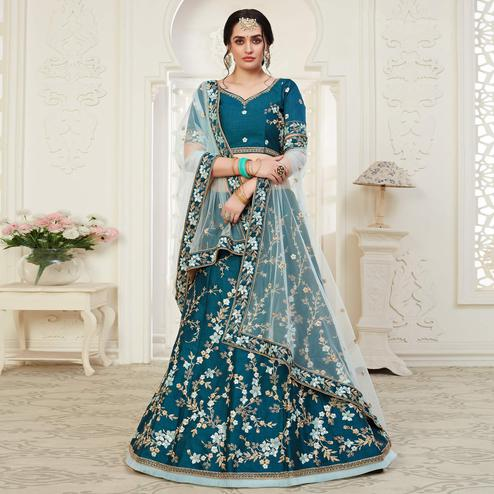 Captivating Peacock Blue Colored Cording Thread & Sequence Embroidery Designer Wedding Wear Net With Mulberry Silk  Lehenga Choli