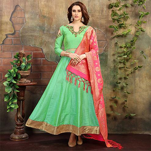 Mesmerising Green Designer Hand Embroidered Partywear Art Silk Gown With Banarasi Silk Dupatta