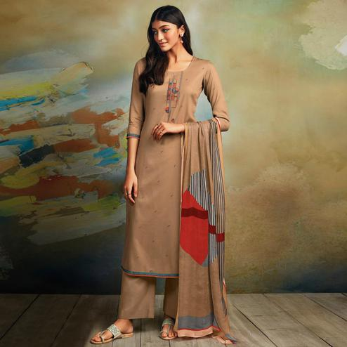 Demanding Beige Colored Partywear Printed and Embroidered Cotton Satin Palazzo Suit