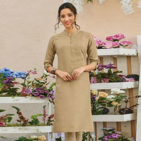 Alluring Beige Colored Casual Wear Solid Pure Rayon Kurti