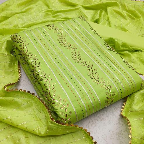 Intricate Green Colored Partywear Embroidered Cotton Dress Material