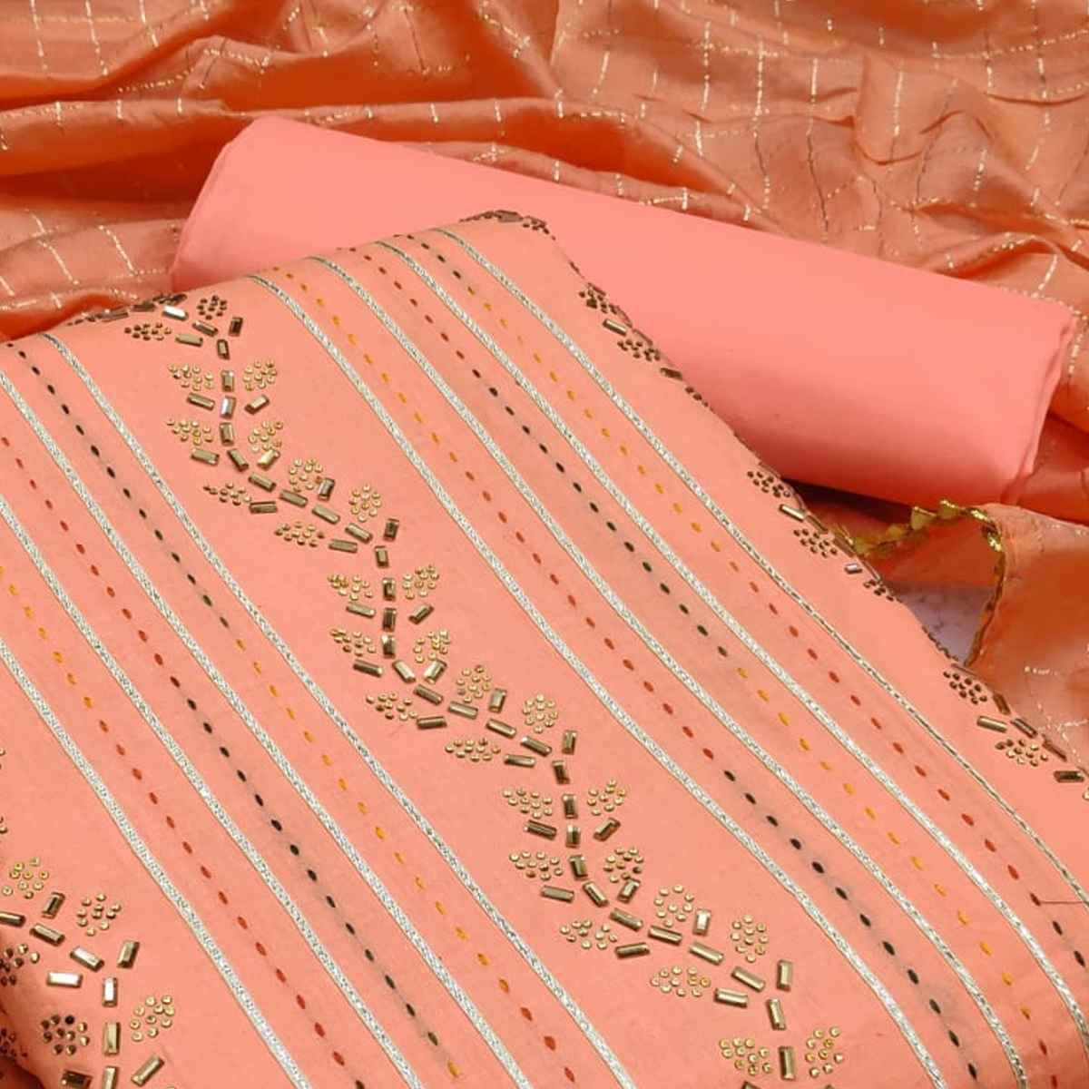 Desirable Peach Colored Partywear Embroidered Cotton Dress Material