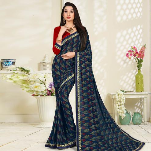 Eye-catching Navy Blue Colored Lace Border Work Printed Casual Wear Georgette Saree