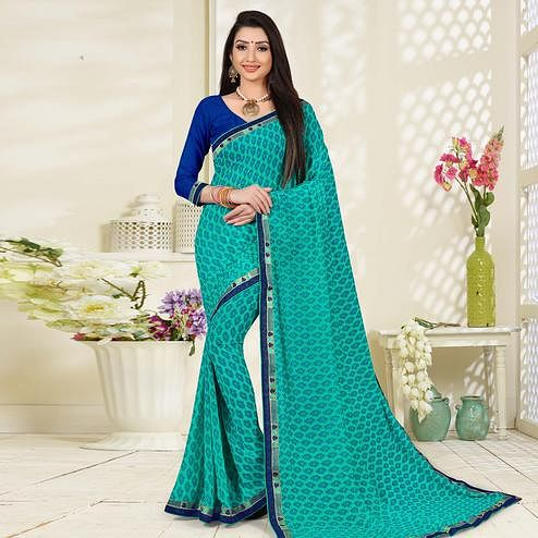 Adorable Turquoish Green Colored Lace Border Work Printed Casual Wear Georgette  Saree