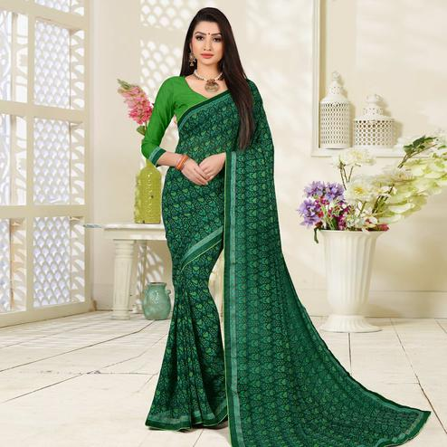 Attractive Green Colored Lace Border Work Printed Casual Wear Georgette  Saree