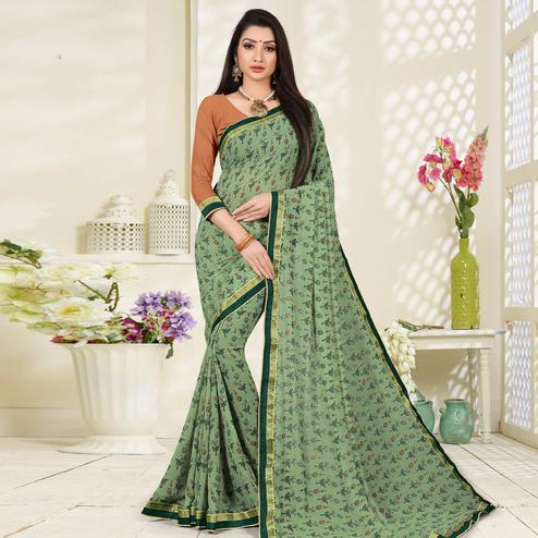 Graceful Light Green Colored Lace Border Work Printed Casual Wear Georgette Saree
