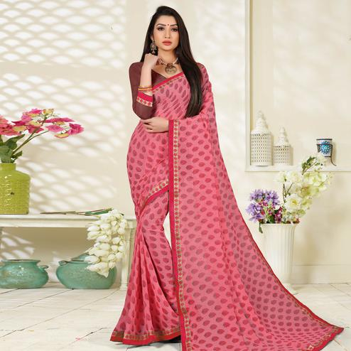 Blooming Peach Colored Lace Border Work Printed Casual Wear Georgette Saree