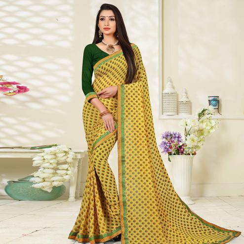 Charming Yellow Colored Lace Border Work  Printed Casual Wear Georgette Saree