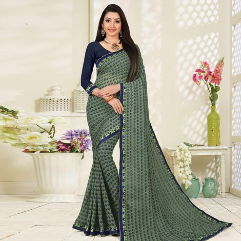 Jazzy Dark Green Colored Lace Border Work Printed Casual Wear Georgette Saree