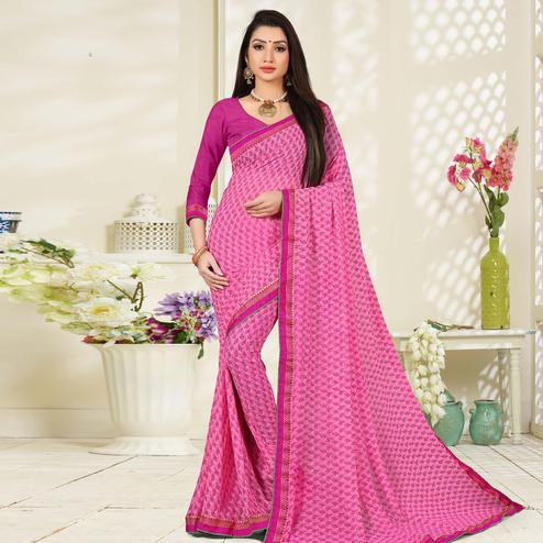 Ravishing Pink Colored Lace Border Work Printed Casual Wear Georgette Saree