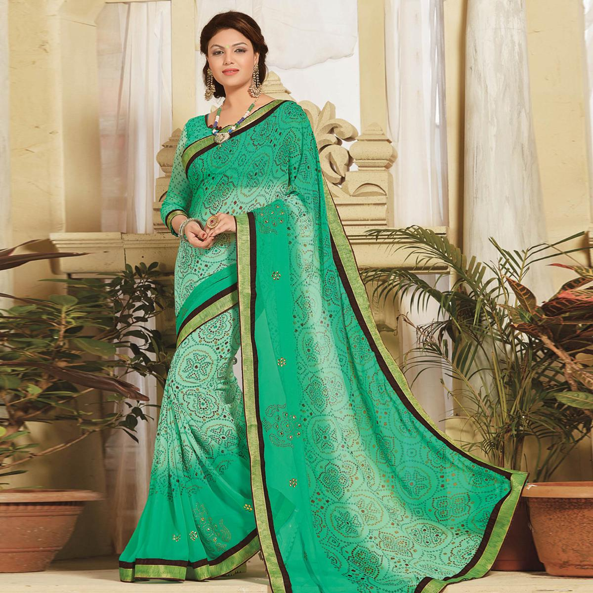 Eye-catching Green Colored Lace Border Work Printed Casual Wear Georgette Saree
