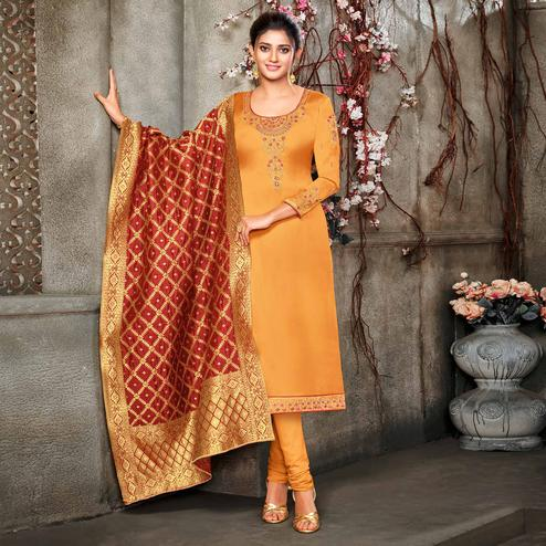 Surpassing Orange Colored Embroidered Partywear Satin Georgette Dress Material