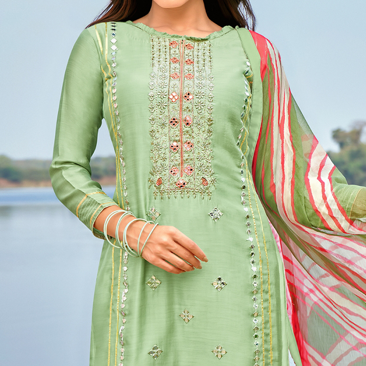 Impressive Pista Green Colored Partywear Embroidered Modal Cotton Dress Material