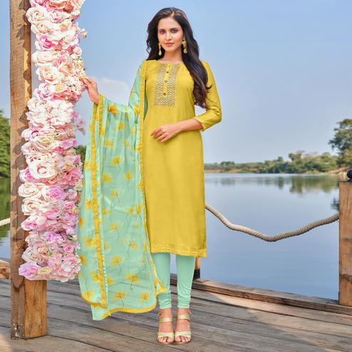 Staring Lemon Yellow Colored Partywear Embroidered Modal Cotton Dress Material