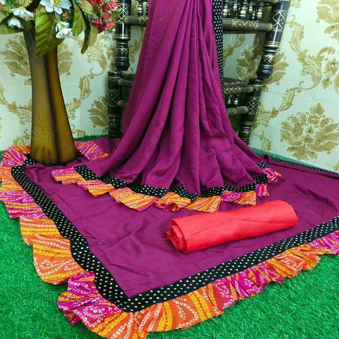 Glorious Wine Colored Partywear Solid Vichitra Silk Saree With Bandhani Print Ruffle