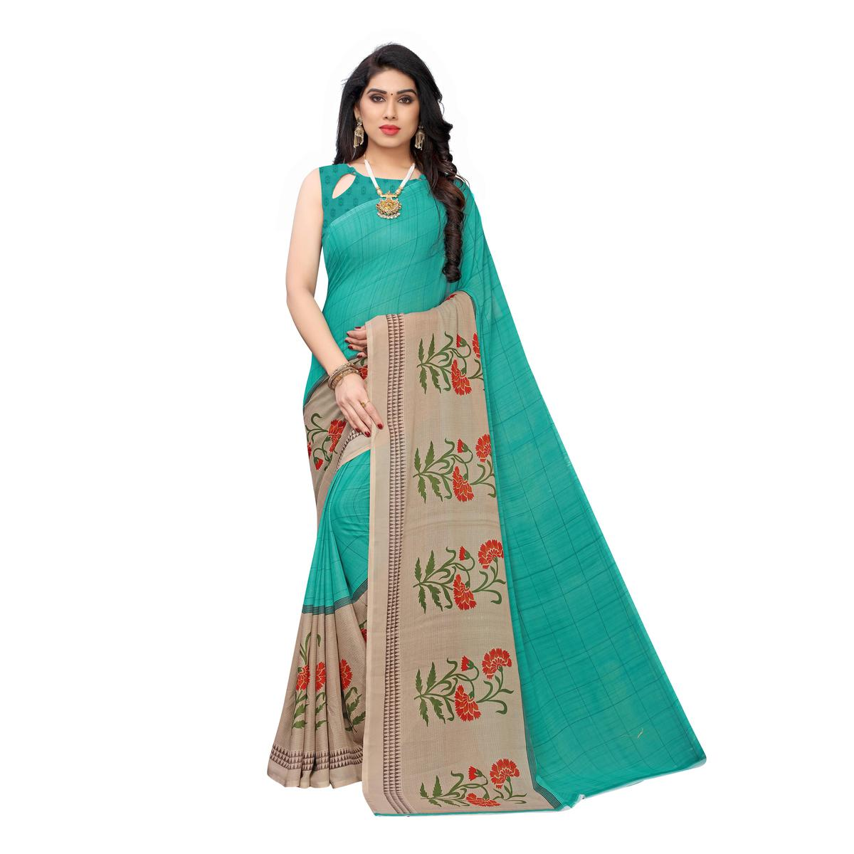 Exotic Turquoise Colored Casual Wear Stripe Printed Georgette Saree