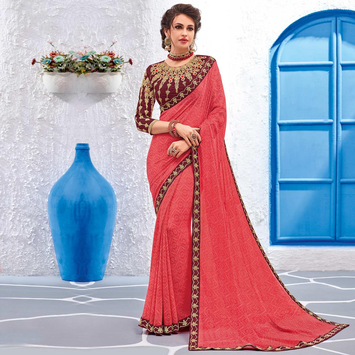 Pretty Pink Colored Designer Printed And Embroidered Partywear Georgette Saree