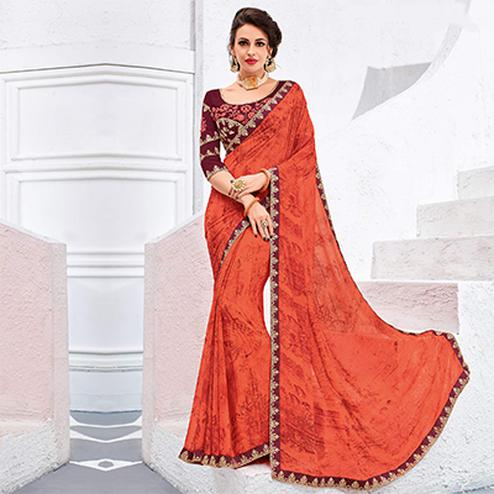 Flamboyant Orange Colored Designer Printed And Embroidered Partywear Georgette Saree
