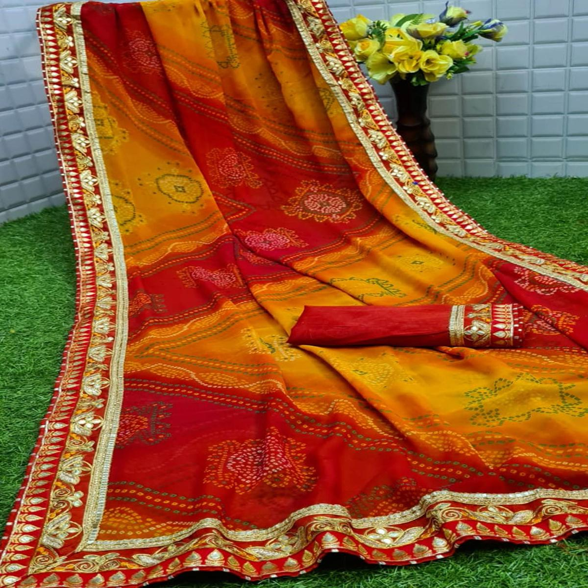 Mesmerising Red - Yellow Colored Partywear Printed Georgette Saree