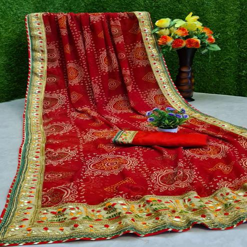 Intricate Red Colored Partywear Printed Georgette Saree