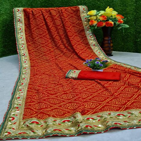Desirable Red Colored Partywear Bandhani Printed Georgette Saree