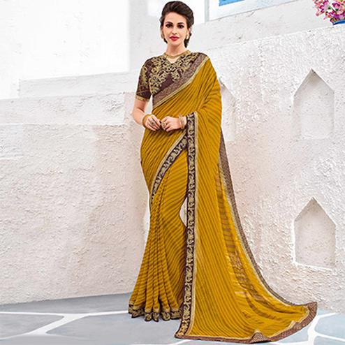 Ravishing Yellow Colored Designer Printed And Embroidered Partywear Georgette Saree