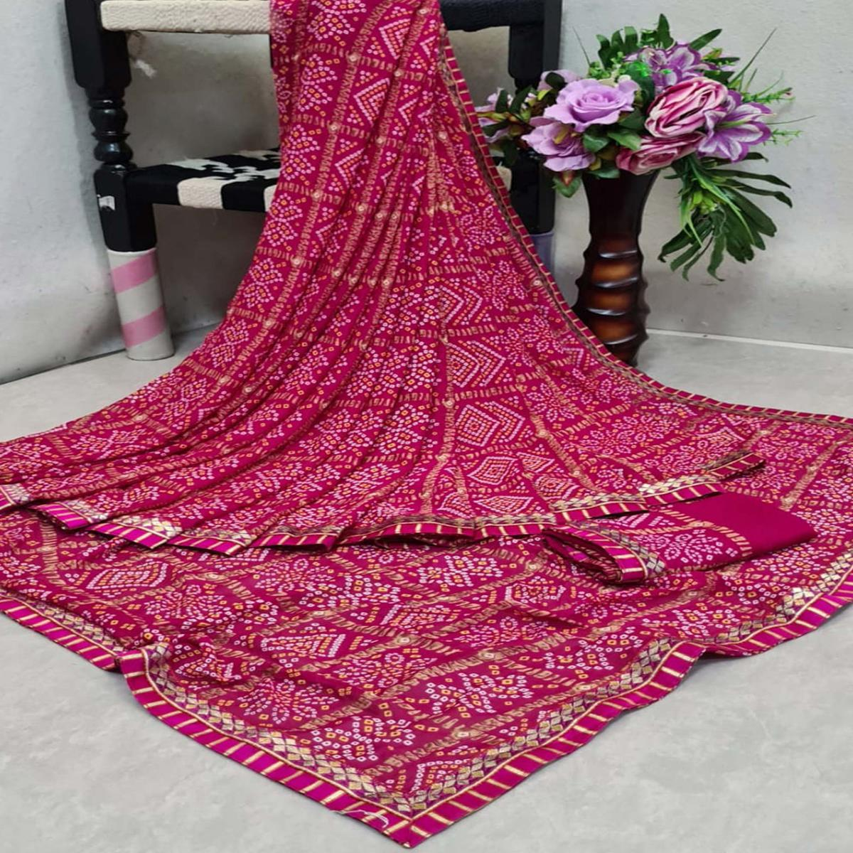 Alluring Magenta Pink Colored Casual Printed Moss Georgette Saree